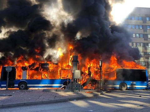 Driver suffers severe burns after bus explodes when it hits low bridge