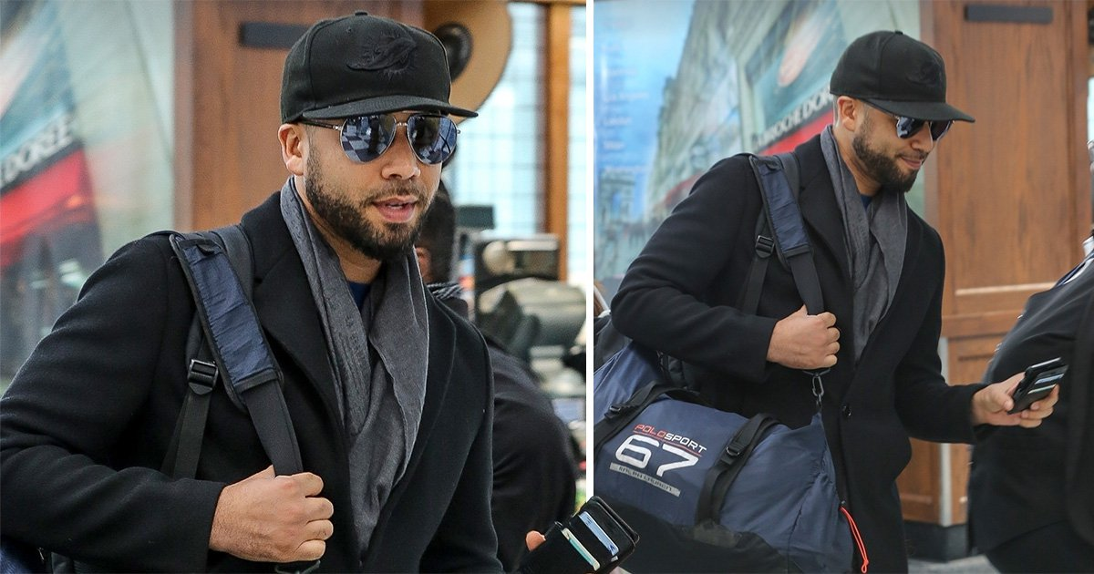 Jussie Smollett cracks a smile as he jets out of Chicago following dropped police charges