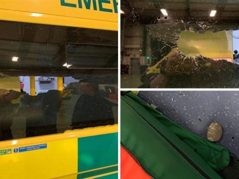 Mindless idiot throws rock at ambulance rushing to save a life