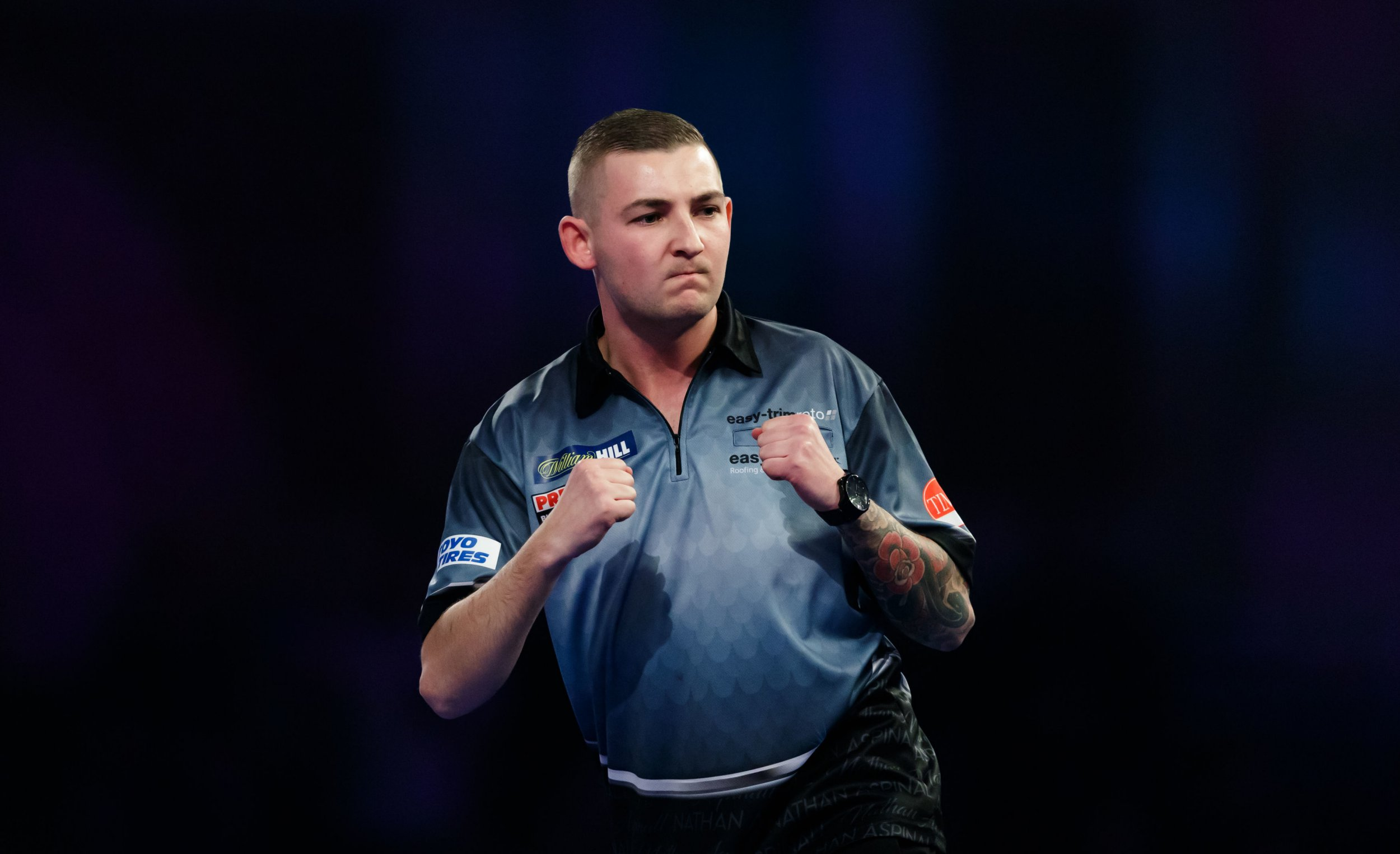 Nathan Aspinall celebrates taking the first set in his match against Darius Labanauskas during day eleven of the William Hill World Darts Championships at Alexandra Palace, London. PRESS ASSOCIATION Photo. Picture date: Sunday December 23, 2018. Photo credit should read: John Walton/PA Wire