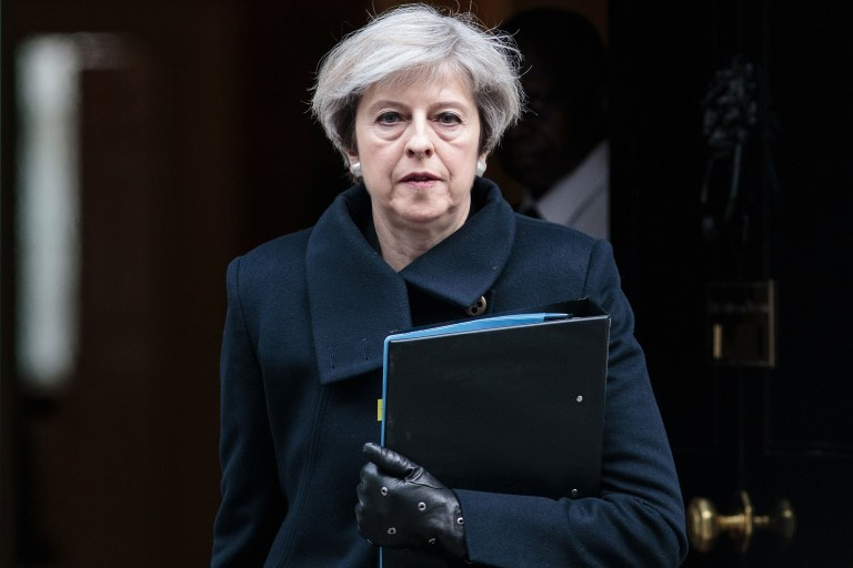 "LONDON, ENGLAND - MARCH 23: Prime Minister Theresa May leaves Downing Street on March 23, 2017 in London, England. The British Prime Minister Theresa May spoke last night after a terrorist attack took place in Westminster, saying Parliament would meet as normal today and ""We will come together as normal"". PC Keith Palmer and three others lost their lives in the attack and the perpetrator was shot dead by police. (Photo by Jack Taylor/Getty Images)"