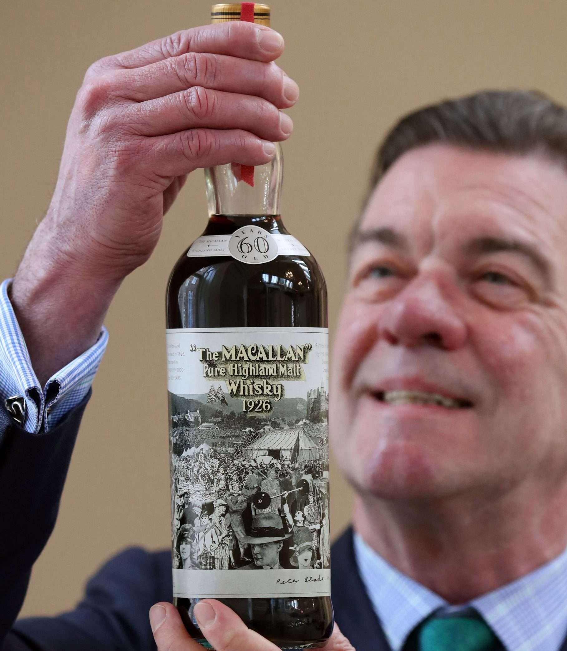 Bonhams whisky expert Martin Green with a bottle of the very rare Macallan-60 year old-1926, that has a label designed by the eminent, internationally acclaimed, British pop artist Sir Peter Blake, which is valued at ??500000-??700000 as part of Bonhams Whisky sale on Wednesday March 6. PRESS ASSOCIATION Photo. Picture date: Monday February 25, 2019. Photo credit should read: Andrew Milligan/PA Wire