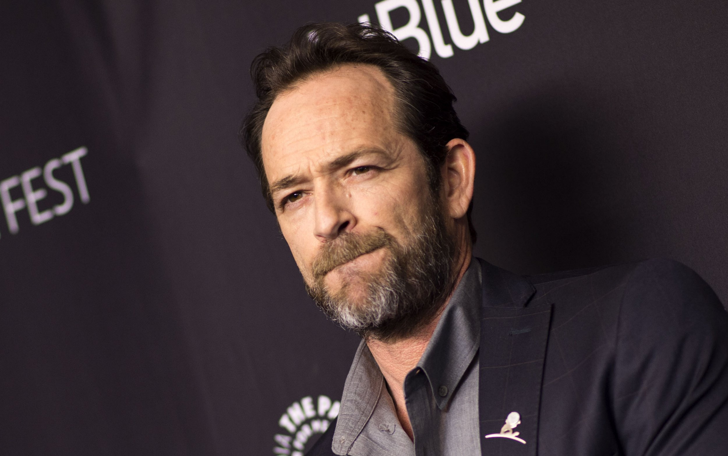 """(FILES) In this file photo taken on March 25, 2018 Actor Luke Perry attends The 2018 PaleyFest screening of """"Riverdale"""" at the Dolby Theater in Hollywood, California. - Actor Luke Perry has been hospitalized after reportedly suffering a massive stroke, US media said February 28, 2019. The """"Beverly Hills, 90210"""" star was rushed to the hospital on Wednesday and remains under observation, his representative told various media outlets, declining to elaborate on the actor's condition.Perry, 52, had been in Los Angeles working on the television series """"Riverdale,"""" a comic book adaptation in which he plays Fred Andrews. (Photo by VALERIE MACON / AFP)VALERIE MACON/AFP/Getty Images"""