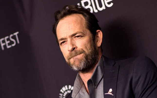 "(FILES) In this file photo taken on March 25, 2018 Actor Luke Perry attends The 2018 PaleyFest screening of ""Riverdale"" at the Dolby Theater in Hollywood, California. - Actor Luke Perry has been hospitalized after reportedly suffering a massive stroke, US media said February 28, 2019. The ""Beverly Hills, 90210"" star was rushed to the hospital on Wednesday and remains under observation, his representative told various media outlets, declining to elaborate on the actor's condition.Perry, 52, had been in Los Angeles working on the television series ""Riverdale,"" a comic book adaptation in which he plays Fred Andrews. (Photo by VALERIE MACON / AFP)VALERIE MACON/AFP/Getty Images"