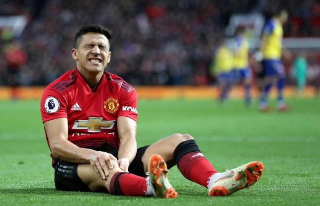 "Manchester United's Alexis Sanchez reacts to an injury during the Premier League match at Old Trafford, Manchester. PRESS ASSOCIATION Photo. Picture date: Saturday March 2, 2019. See PA story SOCCER Man Utd. Photo credit should read: Martin Rickett/PA Wire. RESTRICTIONS: EDITORIAL USE ONLY No use with unauthorised audio, video, data, fixture lists, club/league logos or ""live"" services. Online in-match use limited to 120 images, no video emulation. No use in betting, games or single club/league/player publications"