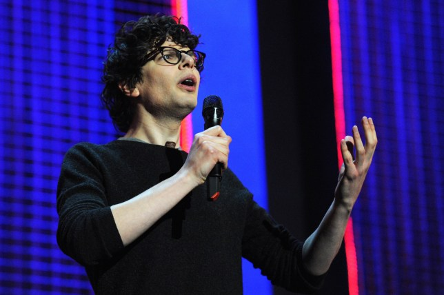 LONDON, ENGLAND - MARCH 06: Simon Amstell performs onstage for 'Give It Up For Comic Relief' at Wembley Arena on March 6, 2013 in London, England. (Photo by Dave J Hogan/Getty Images)