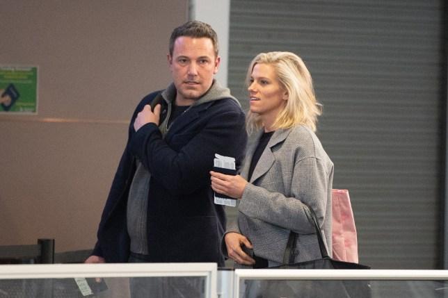Lindsay Shookus and Ben Affleck arrive at JFK airport in NYC. Pictured: Ben Affleck and Lindsay Shookus Ref: SPL5069714 040319 NON-EXCLUSIVE Picture by: SplashNews.com Splash News and Pictures Los Angeles: 310-821-2666 New York: 212-619-2666 London: 0207 644 7656 Milan: 02 4399 8577 photodesk@splashnews.com World Rights,