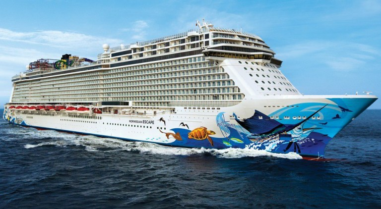 6774139 'Sudden, extreme gusts of wind, estimated at 100 knots' hits Miami-bound Norwegian Escape cruise - sending passengers, tables, chairs and glass 'flying to one side of the ship'