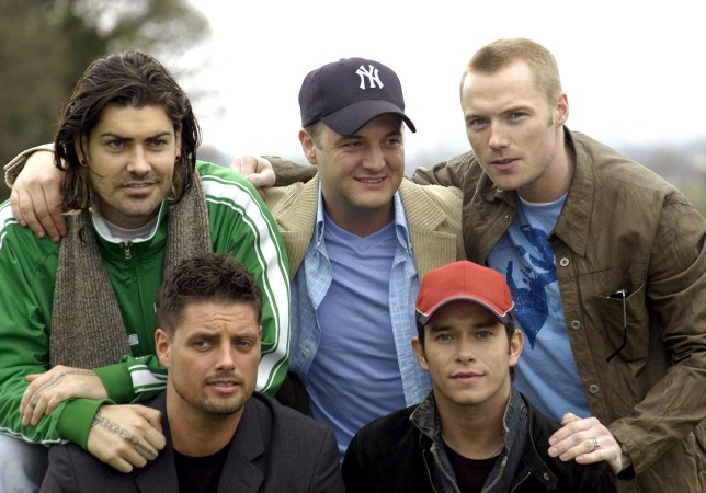 Shane Lynch, Mikey Graham and Ronan Keating (front) Keith Duffy and Stephen Gately at the Palmerstown Stud Golf Club in Dublin, Ireland. (Photo by Tom O'Donnell/WireImage)