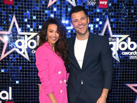 Michelle Keegan and Mark Wright can't wipe the smile from their faces as they hit the red carpet on his return to the UK