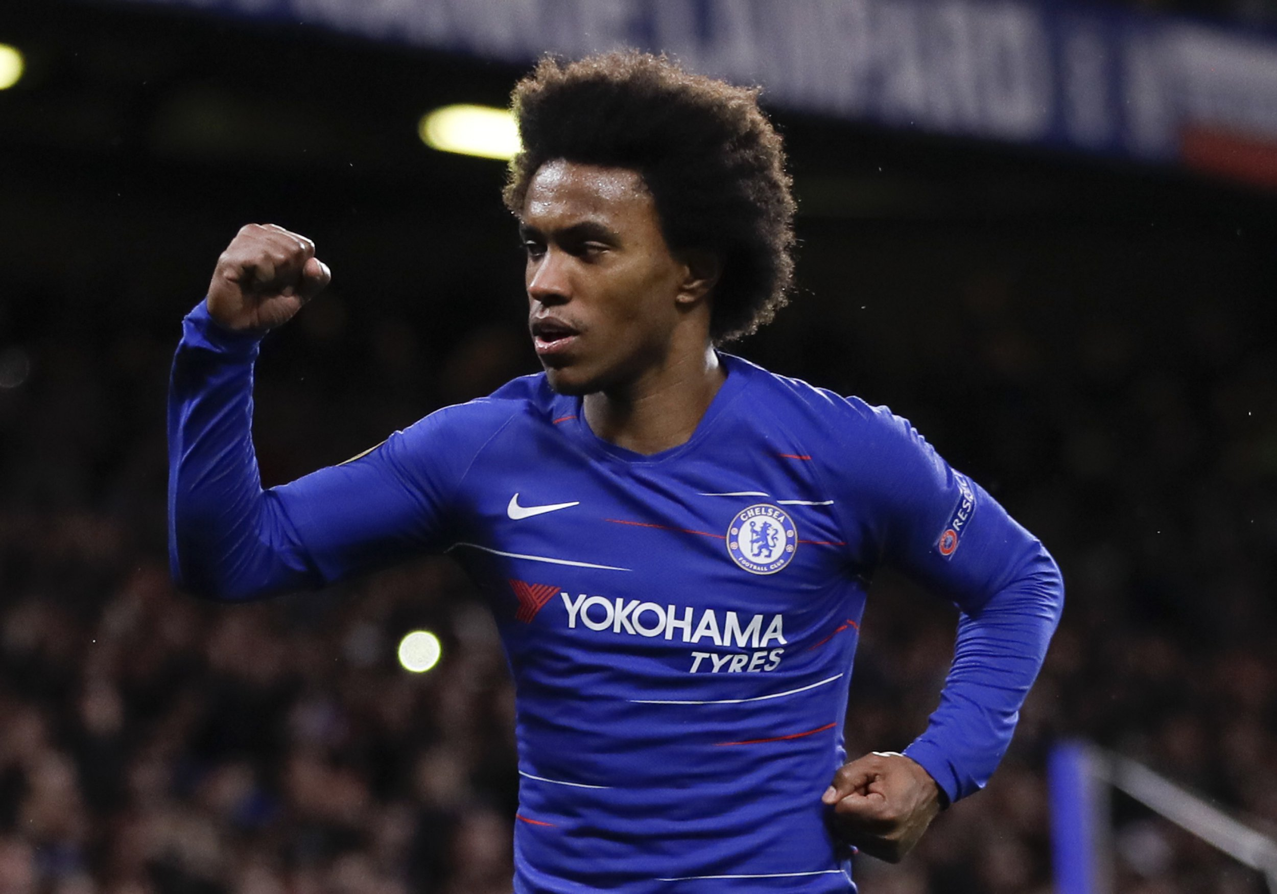 Chelsea's Willian celebrates after scoring his side's second goal during the Europa League round of 16, first leg soccer match between Chelsea and Dynamo Kyiv at Stamford Bridge stadium in London, Thursday, March 7, 2019. (AP Photo/Kirsty Wigglesworth)