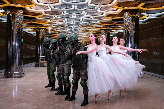 In this undated photo provided by Russian Defense Ministry Press Service, soldiers and ballerinas pose for pictures during a photoshoot in Yekaterinburg, Russia, to mark International Women's Day. When a Russian army recruitment office ordered a photoshoot to celebrate International Women's Day, it didn't feature any of the 45,000 women currently serving in the country's armed forces. While International Women's Day is marked Friday across many countries with calls for gender equality, in Russia it is still a holiday largely focused on celebrating outdated gender roles. (Russian Defense Ministry Press Service via AP)