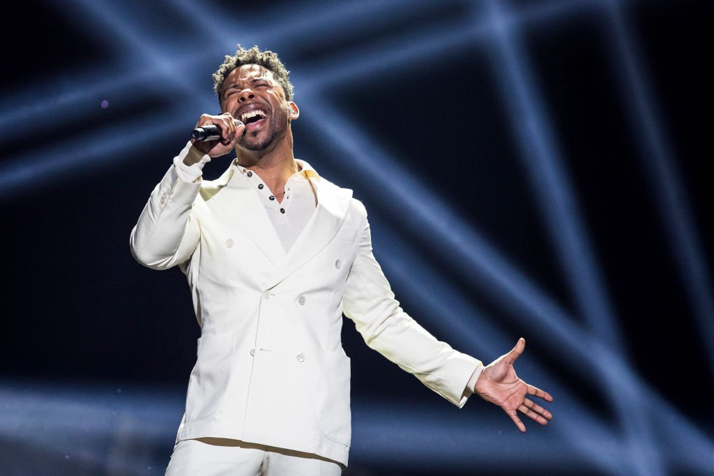 """STOCKHOLM, SWEDEN - MARCH 10: John Lundvik performs the song """"My turn"""" during the grand final of Melodifestivalen on March 10, 2018 in Stockholm, Sweden. Melodifestivalen is an annual music competition in Sweden used to select the Swedish candidate for the Eurovision Song Contest. (Photo by MICHAEL CAMPANELLA/Getty Images)"""
