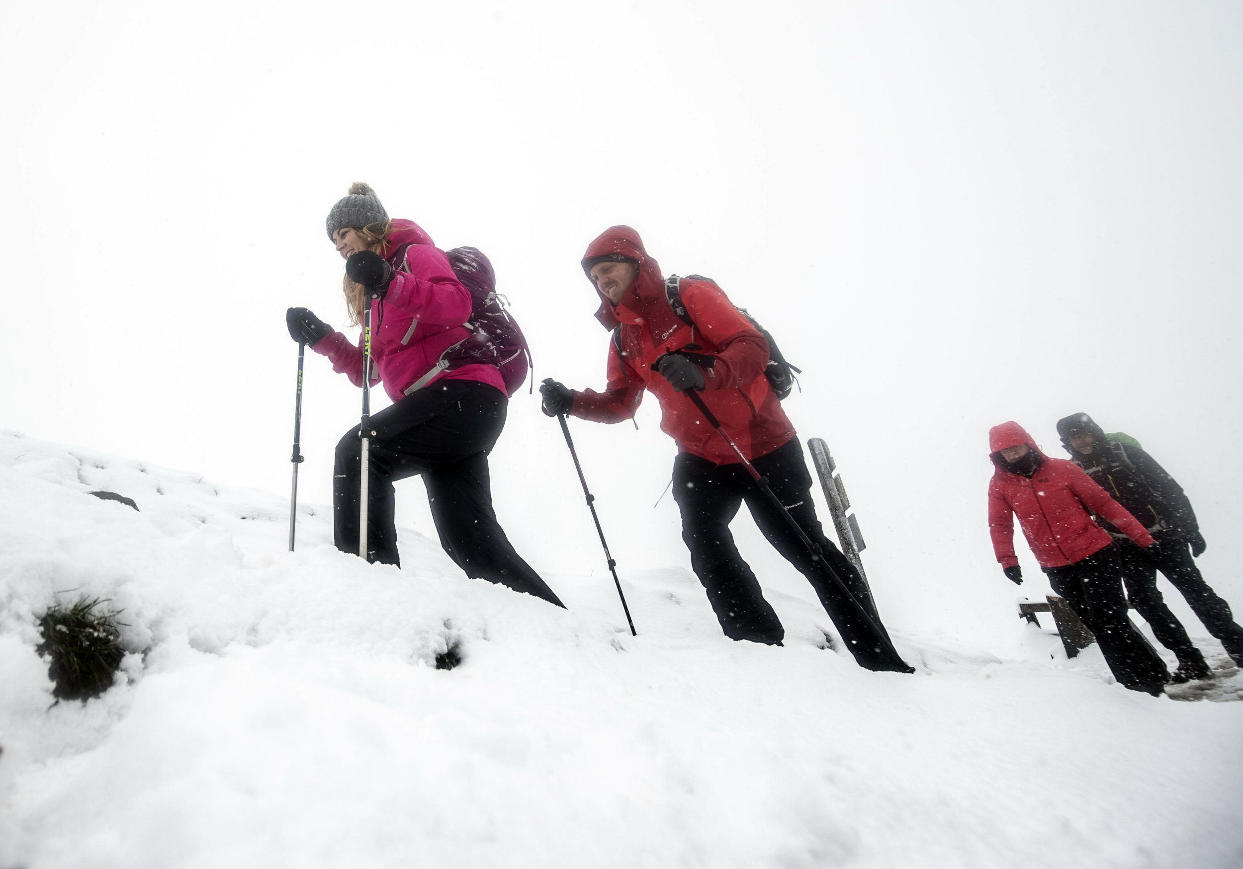 Hikers in whiteout conditions near Mam Tor in the Peak District, Derbyshire, as weather warnings are in place across the UK. PRESS ASSOCIATION Photo. Picture date: Sunday March 10, 2019. Weather warnings for snow and ice are in place across western Scotland and northern Ireland until 11am, while the wintry weather is also set to cause disruption across parts of the Midlands. Photo credit should read: Danny Lawson/PA Wire