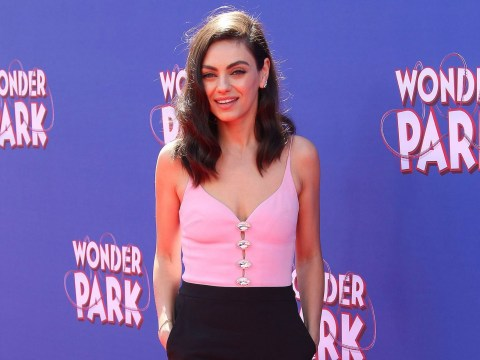 Mila Kunis is pretty in pink as she makes solo appearance on Wonder Park red carpet