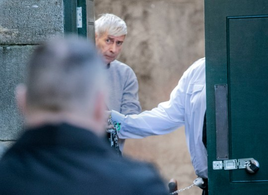 """Geoffrey Crossland is lead away in handcuffs to a prison van after being jailed for more than 12 years at York Crown Court, he amassed one of the largest known hauls of indecent images in England and Wales. PRESS ASSOCIATION Photo. Picture date: Monday March 11, 2019. Officers found a vast collection of more than 2.2 million indecent images on SD cards, laptops and tablets - as well as a """"secret underground bunker"""" containing weapons and ammunition - when they searched his home in North Yorkshire. See PA story COURTS Images. Photo credit should read: Danny Lawson/PA Wire"""
