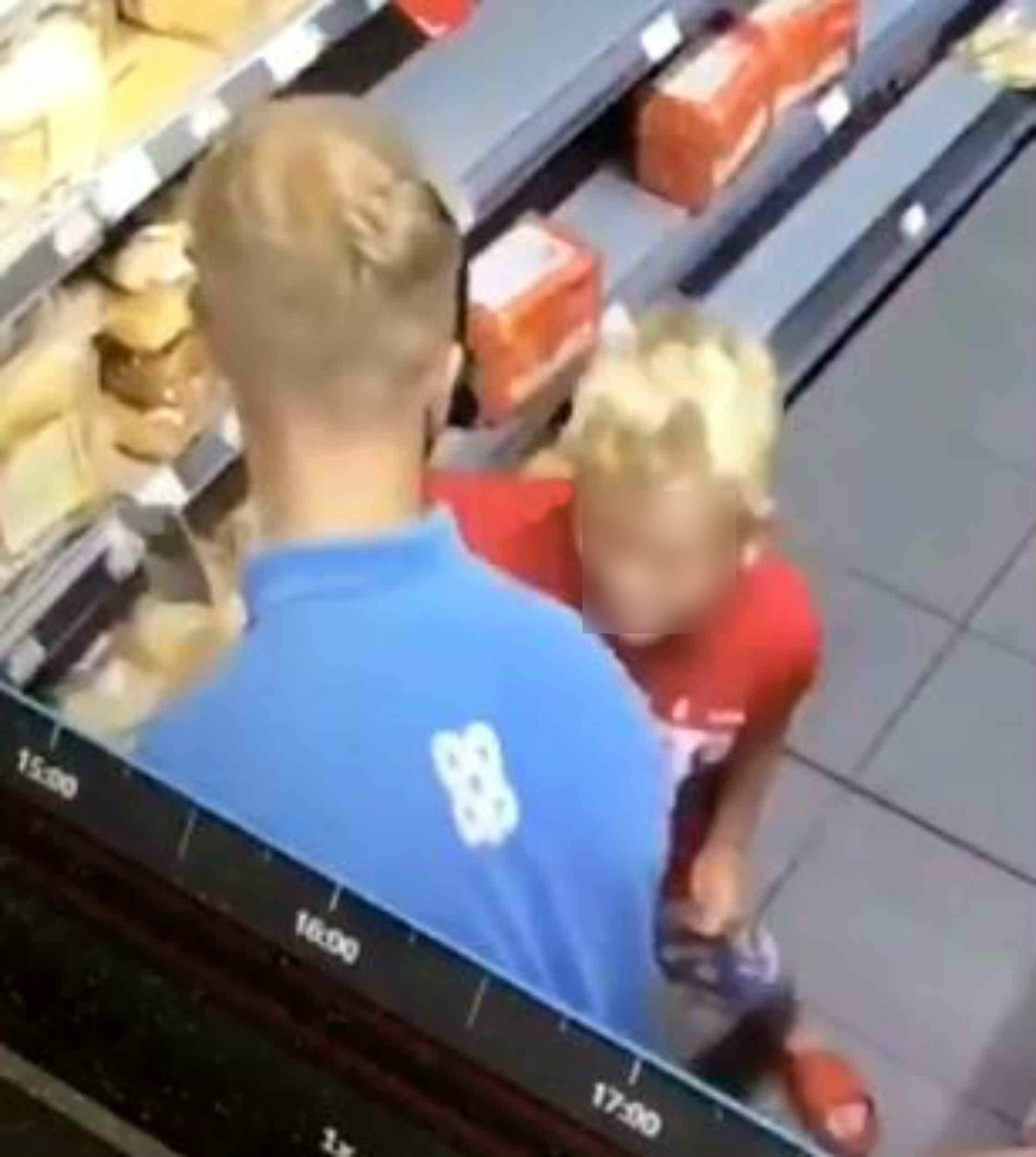 """SHOCKING video shows the moment a supermarket worker snapped and violently shoved a """"little b******"""" boy against shelving. The blond boy, wearing a """"Boss"""" T shirt and aged about nine, had been """"annoying"""" the worker at a store in Ilkeston, Derbyshire. The CCTV footage shows the man push the boy hard with his hand, propelling him into the shelving behind and knocking him off his feet. During the clip, which appears to have been filmed from the store's security camera, a man can be heard saying: """"Little b******"""". The incident is understood to have happened on August 7 last year when temperatures in the area hit 80F (27C) and tempers may have been frayed. The footage has only now emerged on social media and was posted to Sam Smith's Twitter page with the caption: ?Think this might be why Miles got sacked.?"""