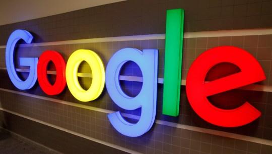 FILE PHOTO: An illuminated Google logo is seen inside an office building in Zurich, Switzerland December 5, 2018. REUTERS/Arnd Wiegmann/File Photo