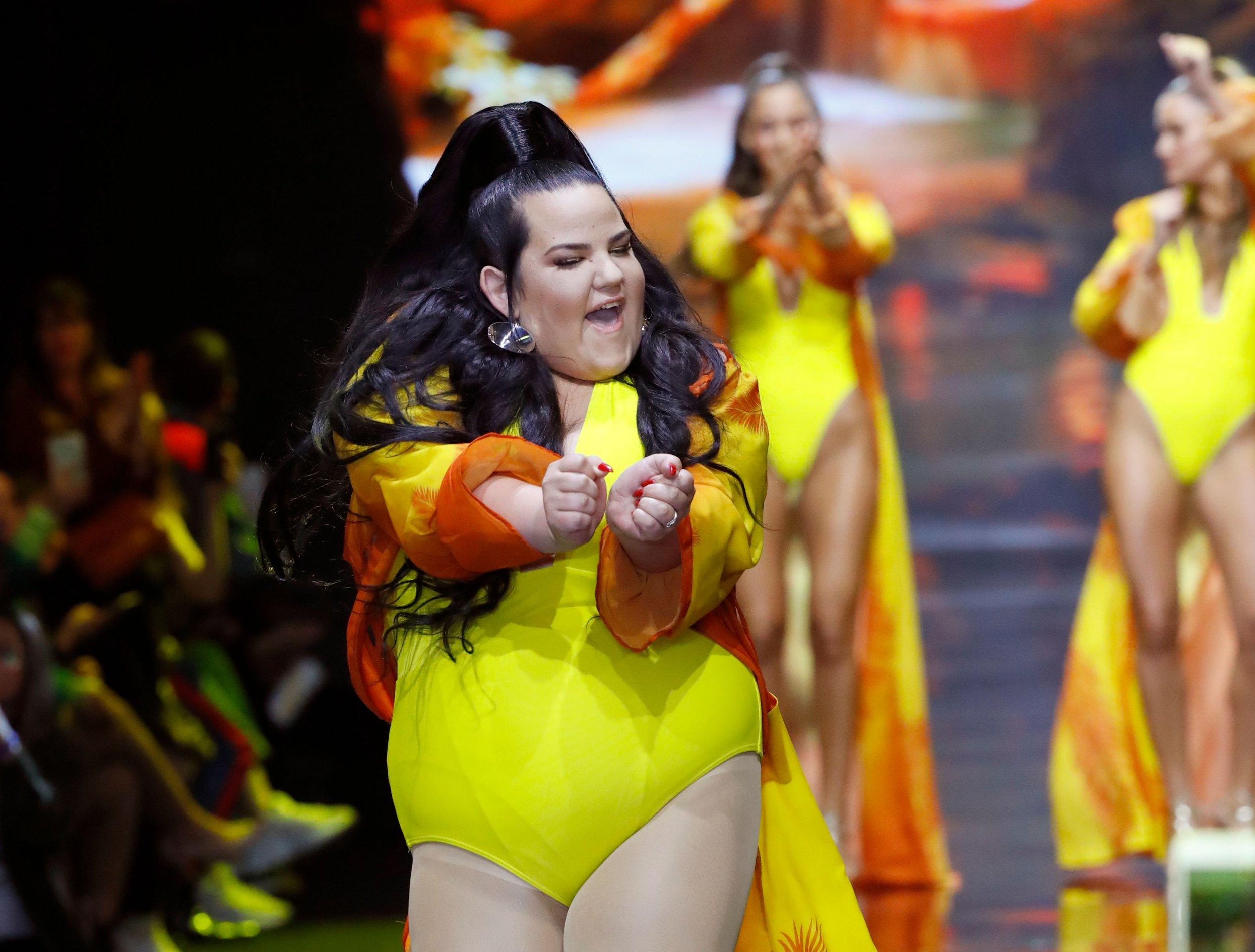 Israeli 2018 Eurovision Song Contest winner Netta Barzilai (C) presents a creation by Israeli designer Bananhot during the Tel Aviv Fashion Week, on March 12, 2019 in the coastal city of Tel Aviv. (Photo by JACK GUEZ / AFP)JACK GUEZ/AFP/Getty Images
