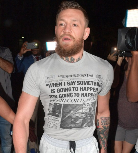 Mandatory Credit: Photo by SMG/REX/Shutterstock (10150935o) Conor McGregor Conor McGregor arrested for allegedly smashing a fan's phone, Miami Beach, Florida, USA - 11 Mar 2019 Former UFC champion Conor McGregor was charged with strong-armed robbery and criminal mischief, both felonies. After an altercation with a fan early Monday morning, according to the Miami Beach police. Seen here wearing sandals, sweats and a t-shirt that says, 'When I say something is going to happen it's going to happen McGregor is back?' McGregor was released from jail at the Turner Guilford Knight Correctional Center on $12,500 bail and than jumped in a black SUV and was driven back to his Miami Beach Mansion.