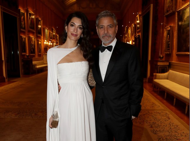 Amal Clooney and George Clooney attend a dinner for donors, supporters and ambassadors of Prince?s Trust International at Buckingham Palace in London. PRESS ASSOCIATION Photo. Picture date: Tuesday March 12, 2019. Photo credit should read: Chris Jackson/PA Wire