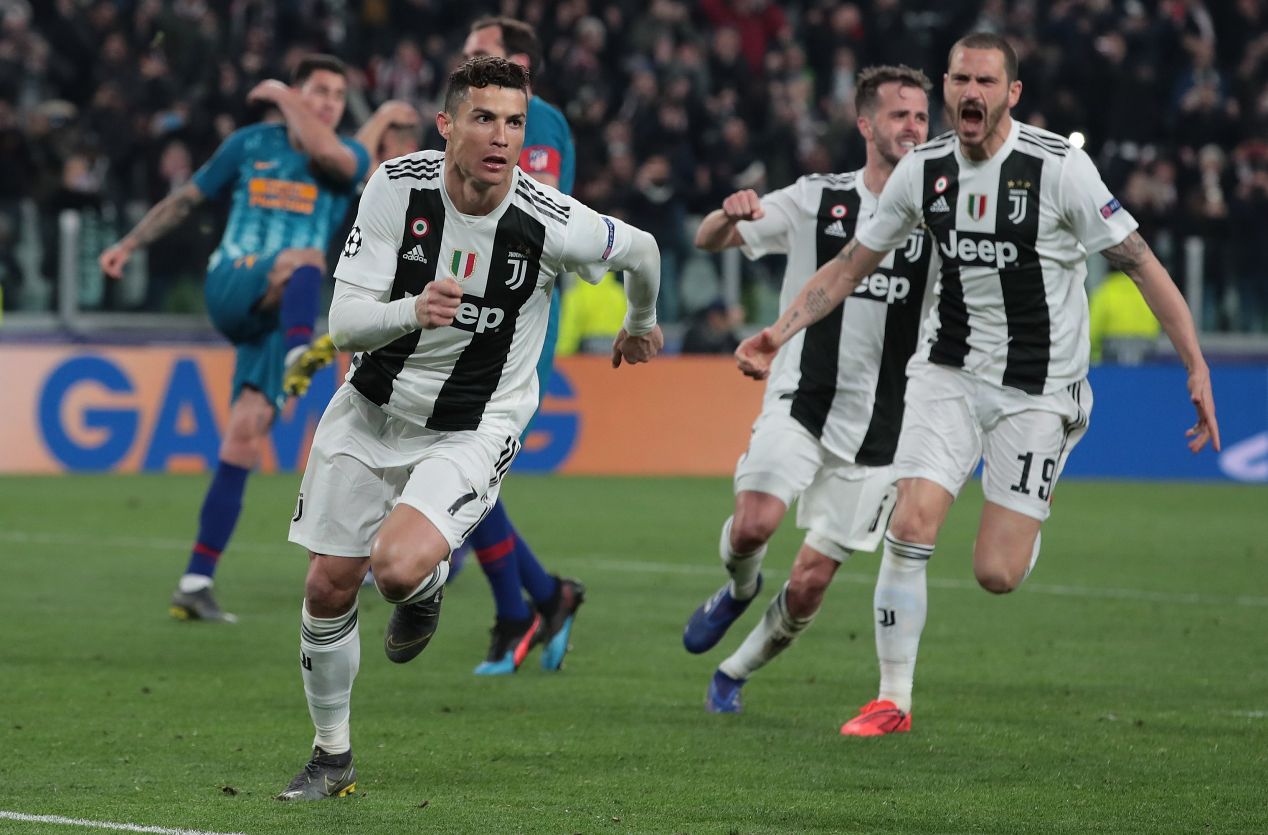 TURIN, ITALY - MARCH 12: Cristiano Ronaldo of Juventus celebrates his third goal during the UEFA Champions League Round of 16 Second Leg match between Juventus and Club de Atletico Madrid at Allianz Stadium on March 12, 2019 in Turin, Italy. (Photo by Emilio Andreoli/Getty Images)