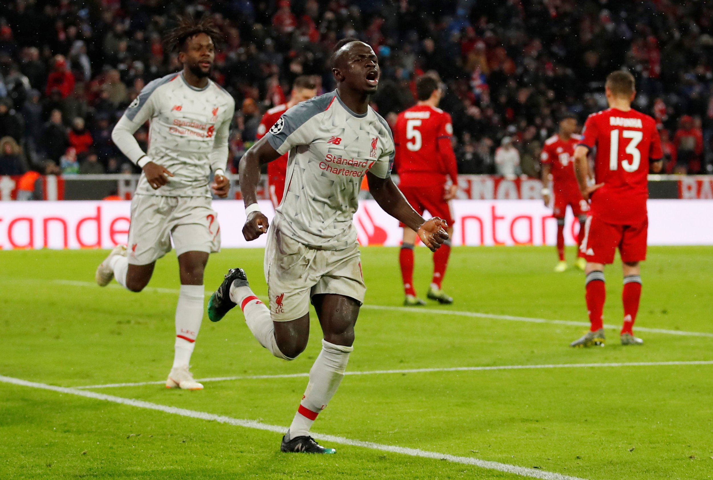 Soccer Football - Champions League - Round of 16 Second Leg - Bayern Munich v Liverpool - Allianz Arena, Munich, Germany - March 13, 2019 Liverpool's Sadio Mane celebrates scoring their third goal with Divock Origi Action Images via Reuters/Andrew Boyers