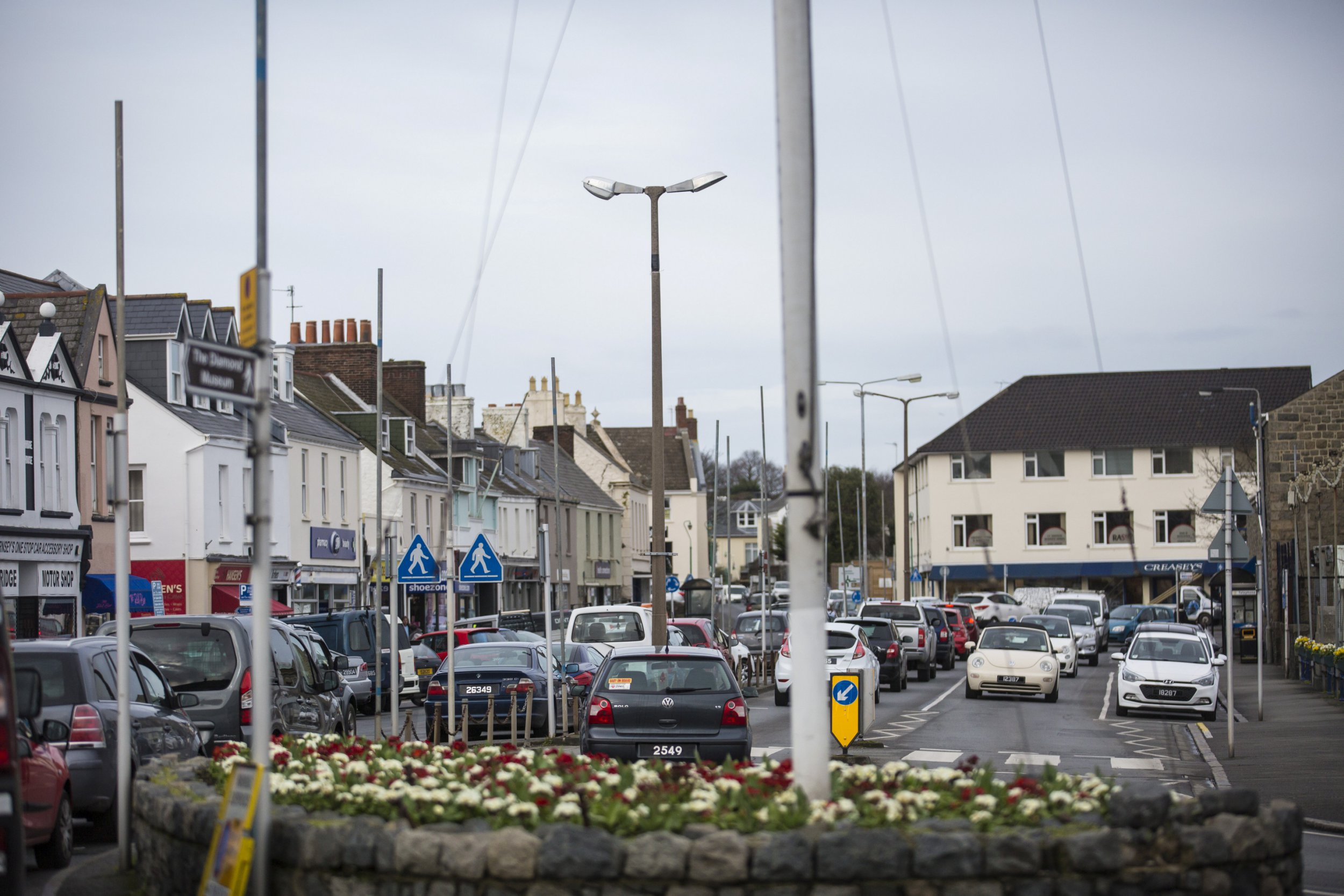 Some of the 135 sign posts, lamp posts and flag poles which have been erected on a single street called the 'The Bridge' in St Sampson, Guernsey. See SWNS story SWPLsigns; A street dubbed the most 'poled' in Britain is facing a pole-axe as a council vows to remove some of its 135 sign posts, lamp posts and flag poles. The short stretch of road is littered with poles of different types - with locals giving it a variety of nicknames including 'Poldark' and 'The Forest Of Poles'. In a stretch of just 500m on the street called 'The Bridge' there are warning signs, shops signs, lamposts, notice signs and flag pole posts. The street is a popular tourist destination in St Sampson, Guernsey, but now locals have had enough - and the issue has been taken to the Channel Island highways department.