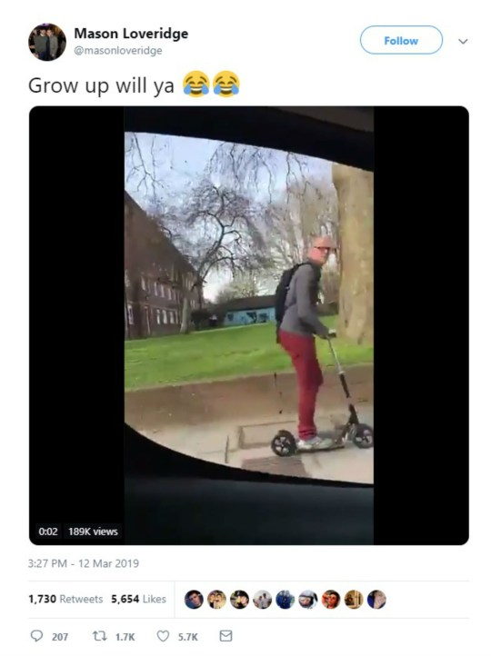 A DRIVER is facing a ferocious backlash after filming himself abusing a grown man on a scooter as a