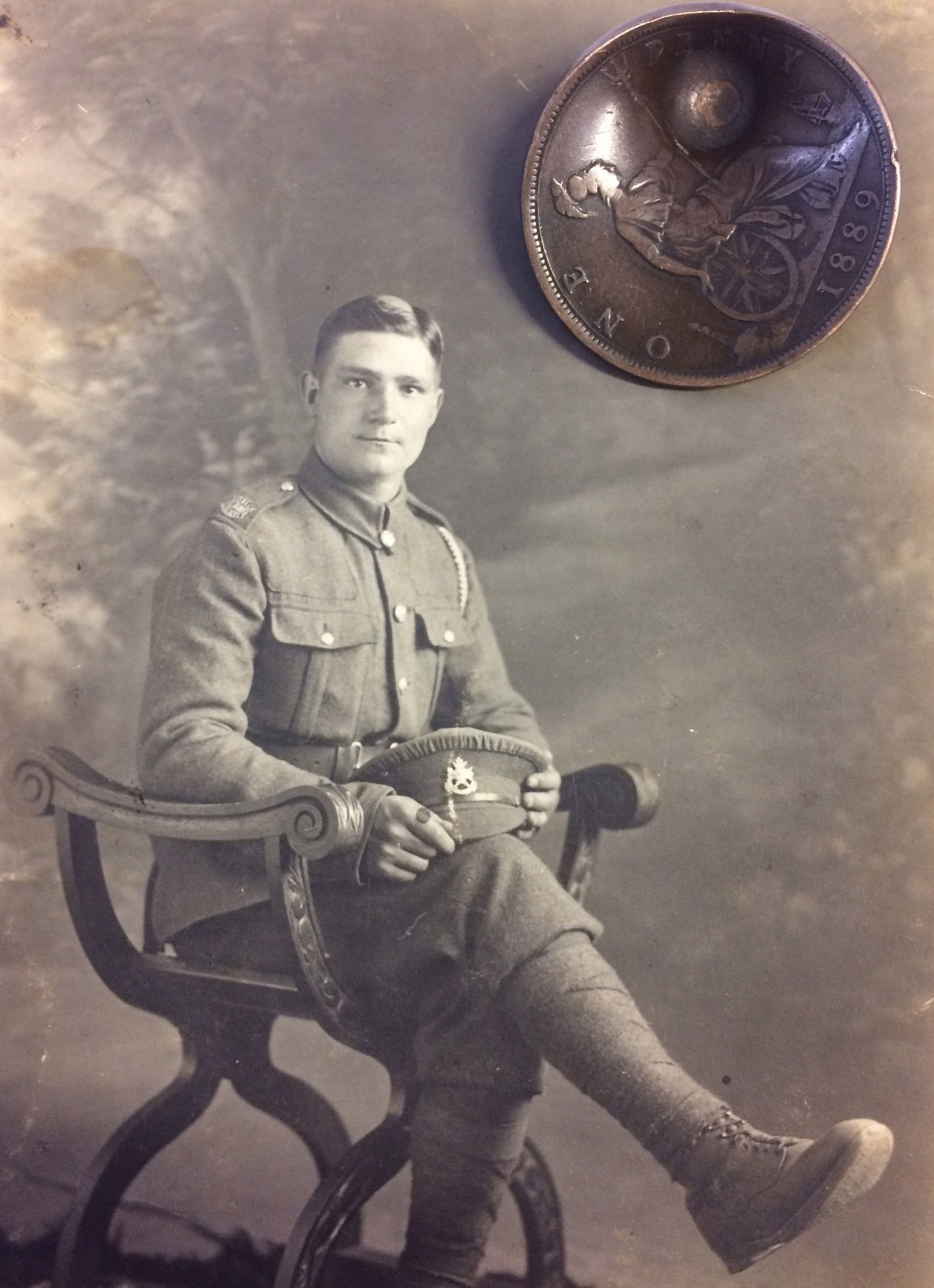 Undated handout photo issued by Hansons Auctioneers of a photograph of Private John Trickett and a dented penny, which deflected an enemy bullet during the First World War One, saving his life, which is due to be sold next week by the Derbyshire-based auction house. PRESS ASSOCIATION Photo. Issue date: Thursday March 14, 2019. Mr Trickett would have been shot in the heart if the bullet ? which still left him deaf ? had not struck the coin in the breast pocket of his uniform. Instead, the round ricocheted through his ear, leading to his honourable discharge from the Northamptonshire Regiment in 1918. See PA story SALE Penny. Photo credit should read: Hansons Auctioneers/PA Wire NOTE TO EDITORS: This handout photo may only be used in for editorial reporting purposes for the contemporaneous illustration of events, things or the people in the image or facts mentioned in the caption. Reuse of the picture may require further permission from the copyright holder.