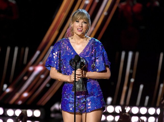 LOS ANGELES, CALIFORNIA - MARCH 14: (EDITORIAL USE ONLY. NO COMMERCIAL USE) Taylor Swift accepts the Tour of the Year award for Reputation Stadium Tour on stage at the 2019 iHeartRadio Music Awards which broadcasted live on FOX at the Microsoft Theater on March 14, 2019 in Los Angeles, California. (Photo by Kevin Winter/Getty Images for iHeartMedia)