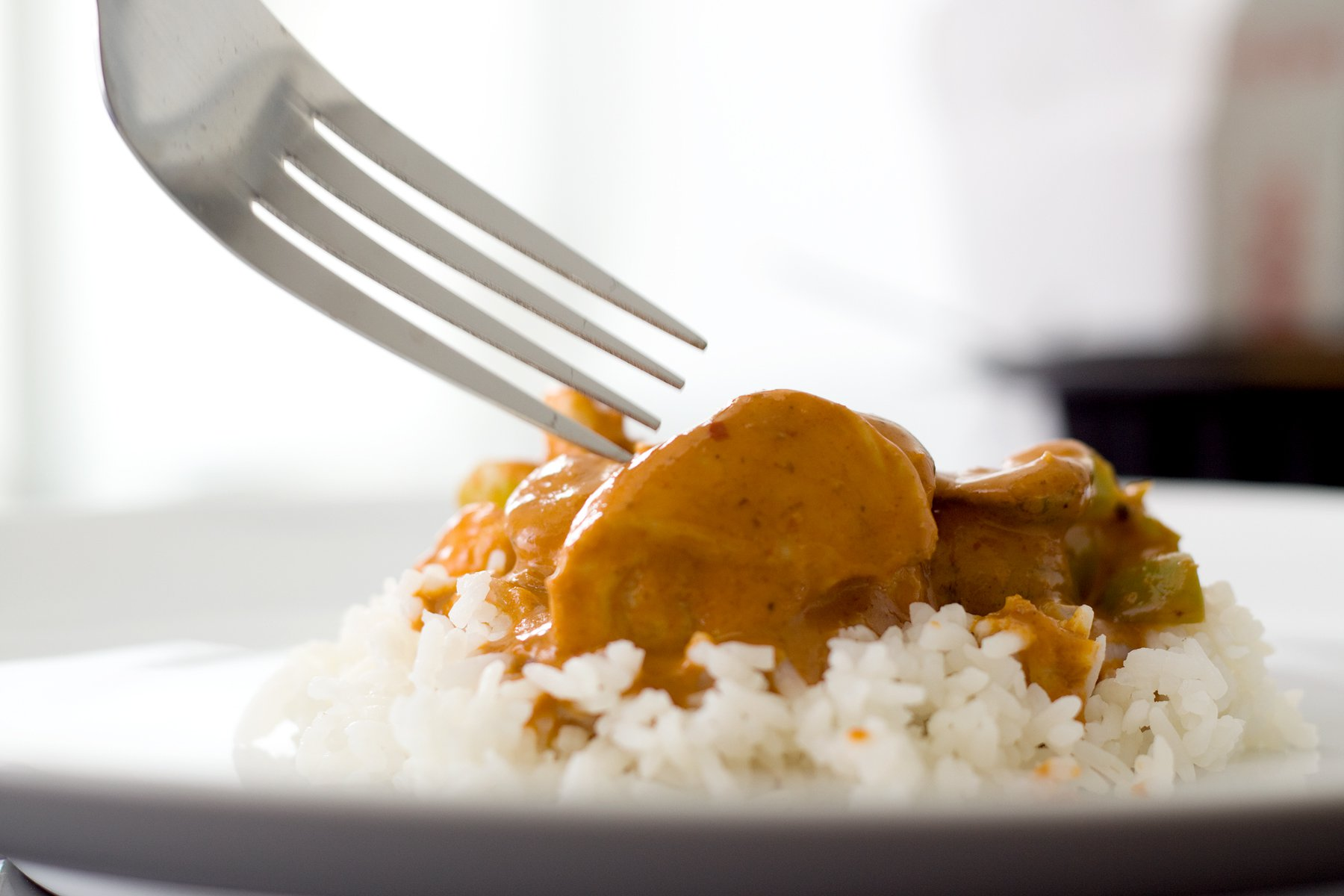 Man jailed for flicking curry and rice at woman, 80