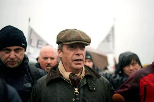 SUNDERLAND, ENGLAND - MARCH 16: Former UKIP leader Nigel Farage in Grangetown, near Sunderland, at the beginning of the 'March to Leave' walk from the Port of Sunderland on March 16, 2019 in Sunderland, England. The 'March to Leave' walk will make its way to London in 14 stages arriving on March 29, the original date for the UK to leave the European Union. (Photo by Christopher Furlong/Getty Images)