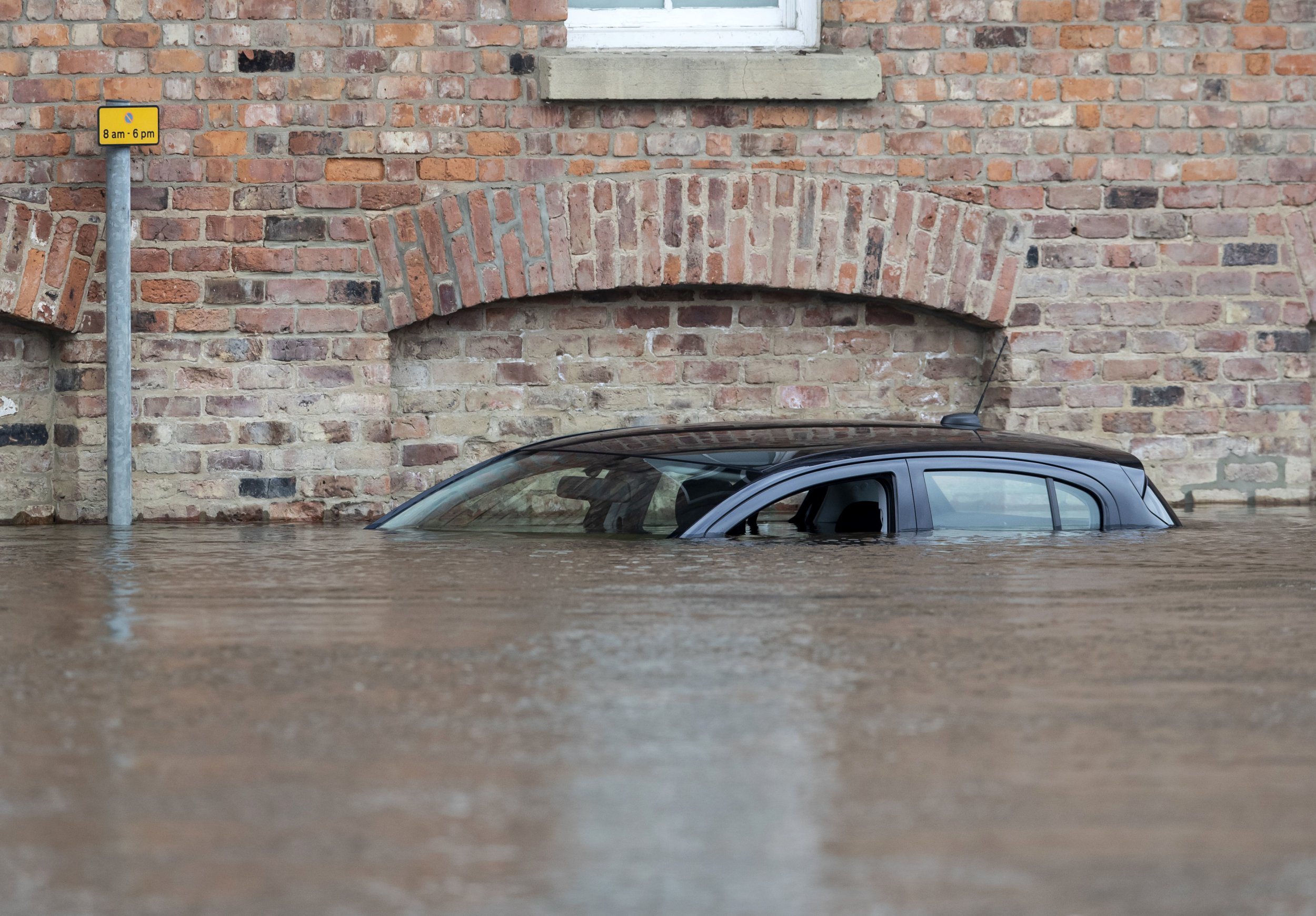 A car is submerged in flood water in York after the River Ouse burst its banks in March 2019