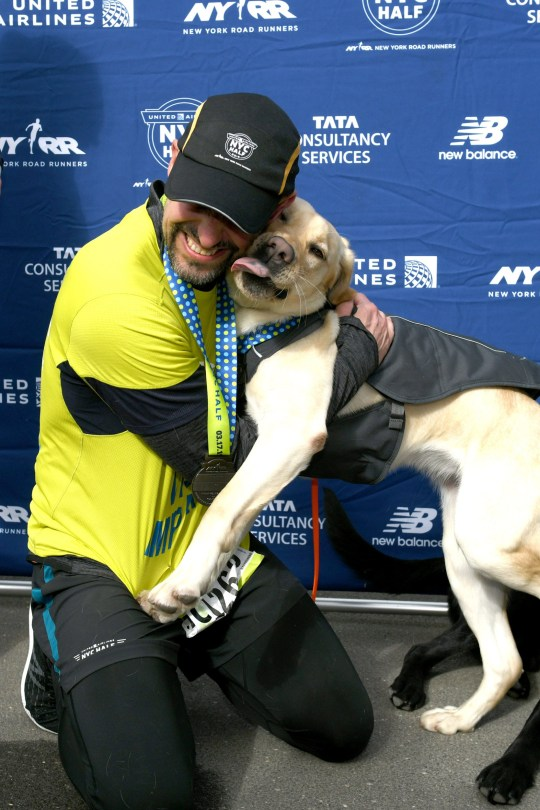 NEW YORK, NEW YORK - MARCH 17: EDITORIAL USE ONLY Waffle joins Guiding Eyes for the Blind President and CEO, Thomas Panek, as he runs the first ever 2019 United Airlines NYC Half Led Completely by Guide Dogs on March 17, 2019 in New York City. (Photo by Craig Barritt/Getty Images for Guiding Eyes For The Blind)