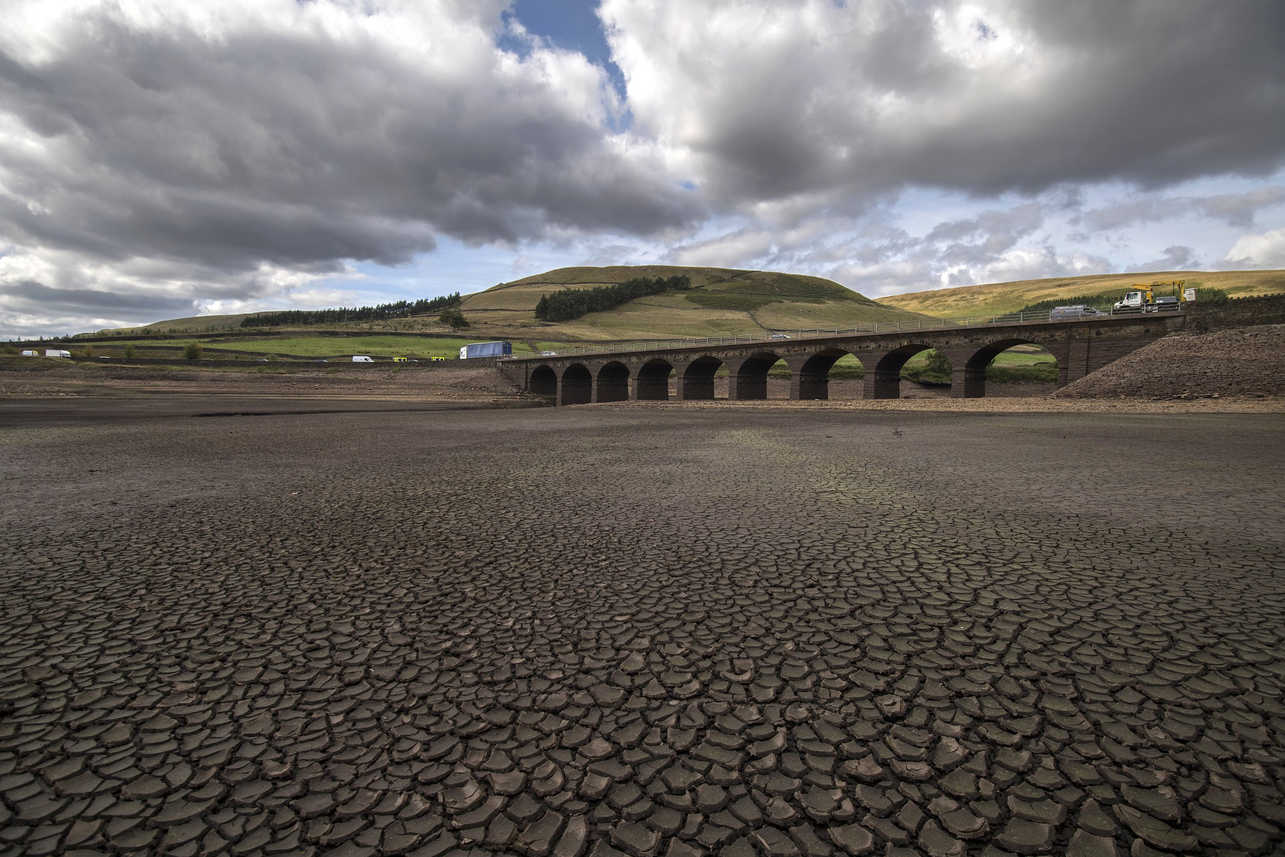MANCHESTER, ENGLAND - SEPTEMBER 13: Woodhead bridge on the A628 stands above the water line as the bottom of Woodhead reservoir is exposed due to low water levels in the Longdendale reservoirs following a long dry summer on September 13, 2018 in Derbyshire, England. When completed in 1877, the six mile long chain of reservoirs built by John Frederick La Trope Bateman was the largest reservoir system in the world and Europe's first major construction scheme (Photo by Anthony Devlin/Getty Images)