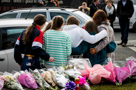 A group of young teenage girls escorted by their families leave floral tributes at the entrance of The Greenvale Hotel in Cookstown Co. Tyrone were three teenagers died on the evening on St Patrick's Day. PRESS ASSOCIATION Photo. See PA story ULSTER Cookstown. Picture date: Tuesday March 19, 2019. Photo credit should read: Liam McBurney/PA Wire