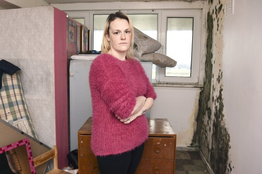 "Mum of three Stacey McNeill is disgusted at having to live in her flat in Muirhouse, Edinburgh, with her walls covered in mould. See SWNS story SWSCmould; A mum-of-three has slammed the council for forcing her young family to stay in an ???unlivable??? sodden flat for months - with the walls covered in mould. Stacey McNeill, 28, shares her 13th floor flat with husband Jai, 28, daughter Amy, seven, and sons Jai, four, and one-year-old olly. However, the mum-of-three has seen her two-bedroom flat of six years deteriorate into an alarming state with black walls, rotten window sills and saturated ceilings. And as a result of the damp conditions, two of Stacey's children end up being sent to hospital. The ""disgusting"" flat in Muirhouse, Edinburgh, is also putting a strain on Stacey's relationship with her partner as he ends up having to sleep on the sofa due to his asthma."