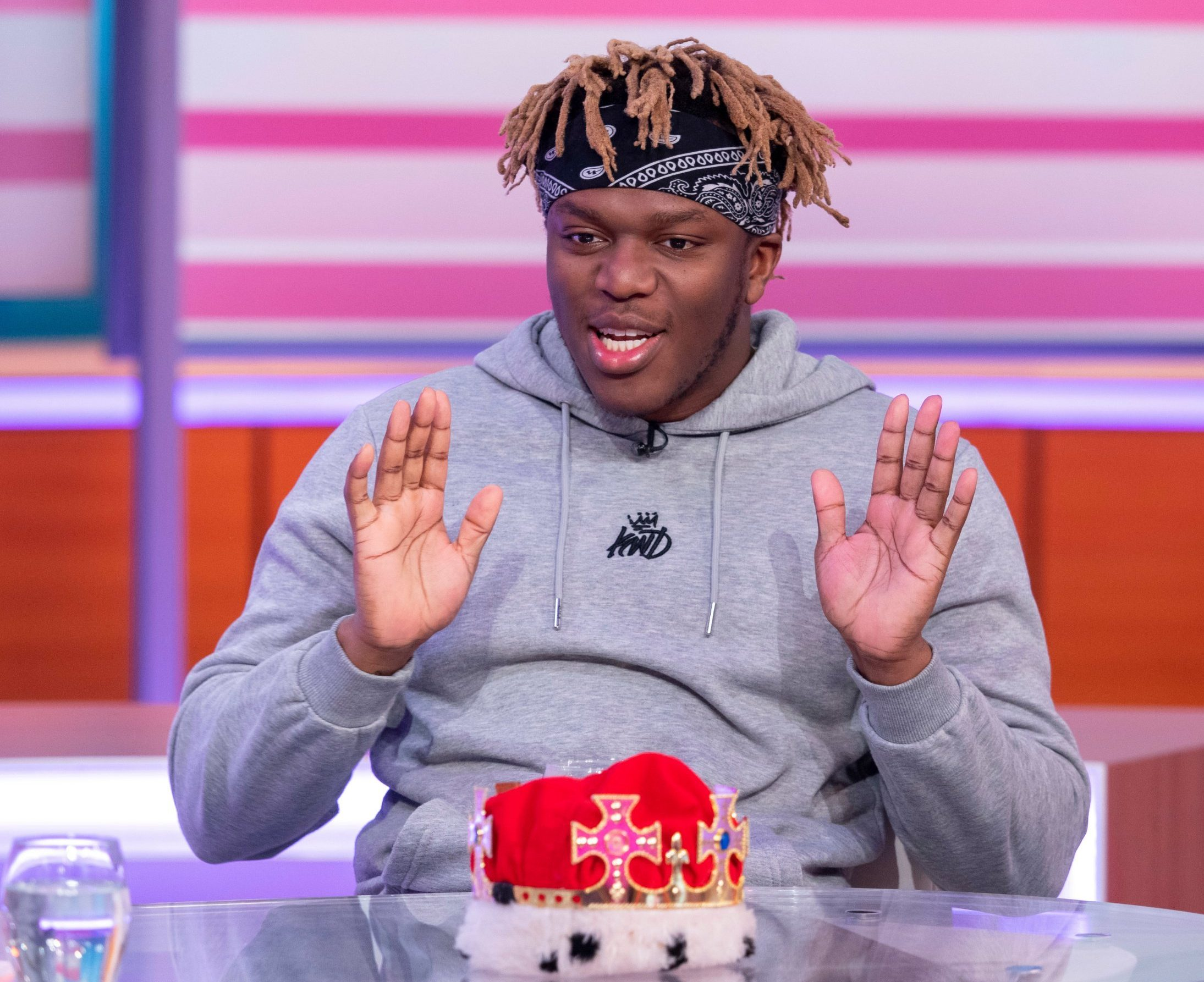 Editorial use only Mandatory Credit: Photo by Ken McKay/ITV/REX (10160896ab) KSI 'Good Morning Britain' TV show, London, UK - 20 Mar 2019 KSI: CAN HE KEEP HIS CROWN? Ding ding? round 2! The YouTube and Instagram superstar is back - after being crowned the 'King Of The Internet' following a challenge by Piers Morgan last year - to talk about his UK tour, the pressures of being an online star and why his rematch with Logan Paul is now in jeopardy. CLIPS: Requested free clips of the KSI vs Logan match from last year + tour trailer with Randolph (as they're touring together) ULAY: Recap of KSI crowned King of the Internet WALK ON PROPS: Regal gown and crown