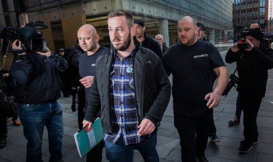 Protester James Goddard (centre) leaves Manchester Magistrates' Court, where he was charged with assault and a public order offence at a protest in Manchester city centre on February 9. PRESS ASSOCIATION Photo. Picture date: Wednesday March 20, 2019. See PA story COURTS Goddard. Photo credit should read: Danny Lawson/PA Wire