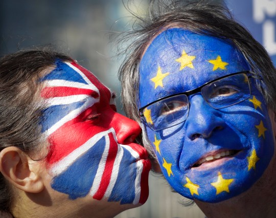 epa07452917 Two protesters with their faces painted with the colors of EU and British flags during a protest staged by about 20 anti-Brexit demonstrators calling for a second referendum on Brexit in front of EU Commission Building ahead of EU Summit in Brussels, Belgium, 21 March 2019. European Union leaders will gather for a two-day summit to discuss, among others, Brexit and British PM request to extend Article 50. EPA/OLIVIER HOSLET