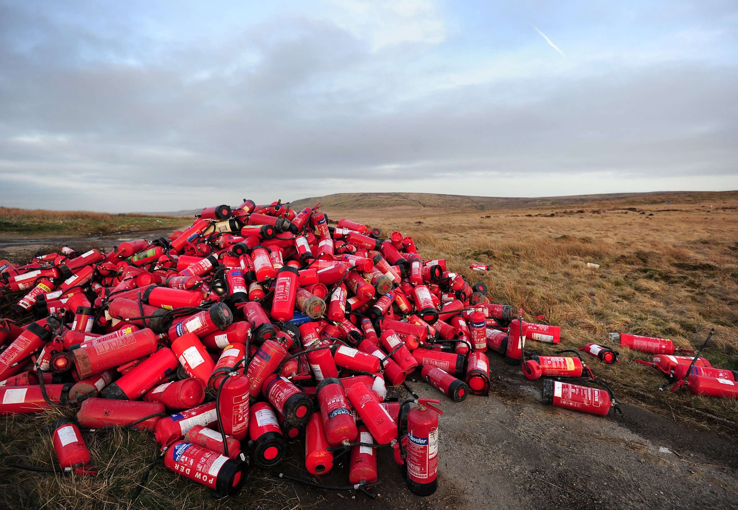 Mountain of 400 fire extinguishers found dumped on moorland