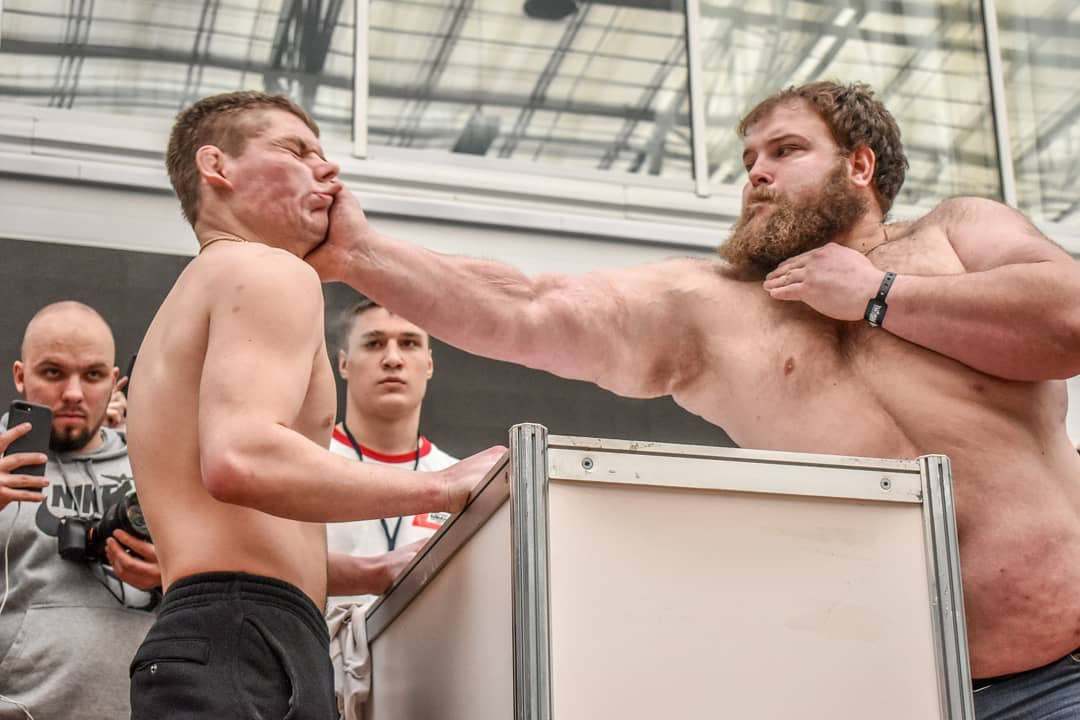 Participants slap each other during the the Male Slapping Championships at the Siberian Power Show in Krasnoyarsk, Russia. (Picture: Dmitry Kotov)