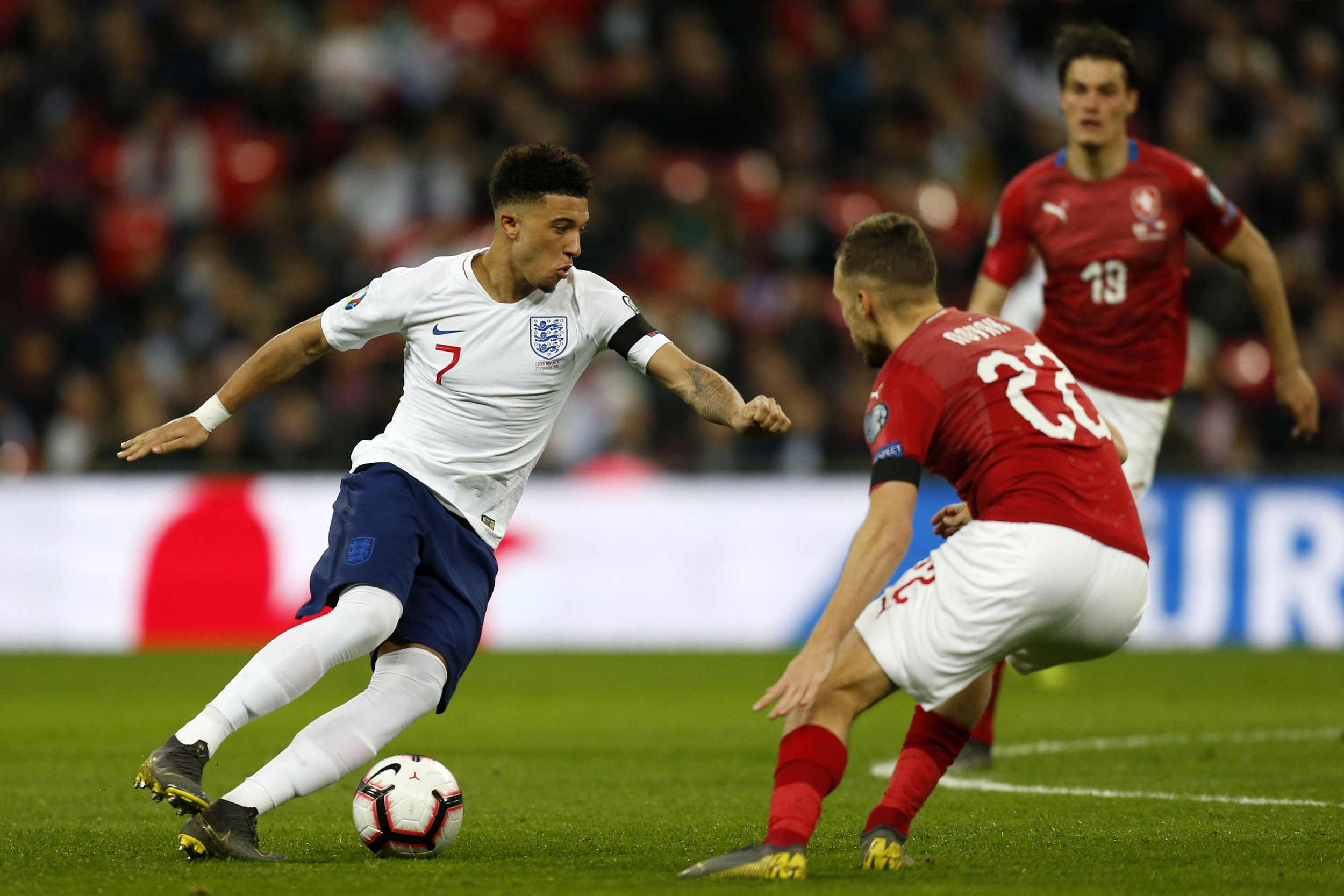 England's midfielder Jadon Sancho (L) vies with Czech Republic's midfielder Filip Novak during the UEFA Euro 2020 Group A qualification football match between England and Czech Replublic at Wembley Stadium in London on March 22, 2019. (Photo by Ian KINGTON / AFP) / NOT FOR MARKETING OR ADVERTISING USE / RESTRICTED TO EDITORIAL USEIAN KINGTON/AFP/Getty Images