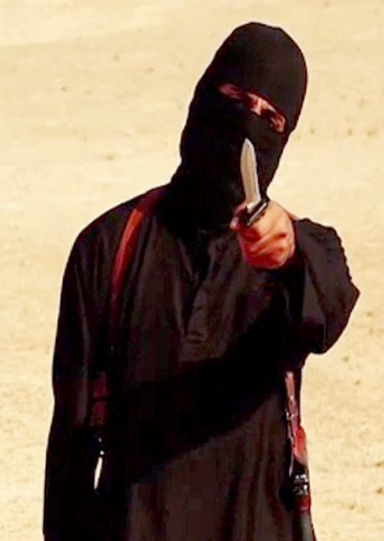 "This file image grab taken from a video released by the Islamic State (IS) and identified by SITE Intelligence Group on September 2, 2014 purportedly shows a masked militant holding a knife and gesturing as he speaks to the camera in a desert landscape before beheading 31-year-old US freelance writer Steven Sotloff. - Kurdish-led forces announced on March 23, 2019 they had fully captured the Islamic State group's last bastion in eastern Syria and declared the total elimination of the jihadists' ""caliphate"". (Photo by HO / SITE Intelligence Group / AFP)HO/AFP/Getty Images"