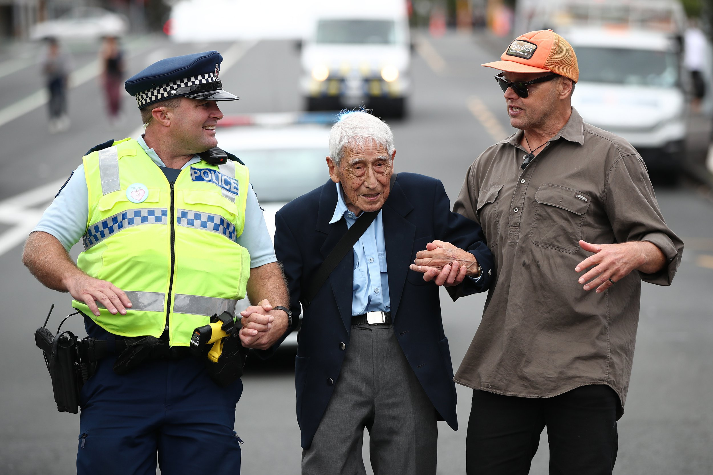 AUCKLAND, NEW ZEALAND - MARCH 24: John Sato (C) 95, one of only two Japanese servicemen in the New Zealand army in WWII, took two buses from Howick to join the march against racism at Aotea Square on March 24, 2019 in Auckland, New Zealand. 50 people were killed, and dozens were injured in Christchurch on Friday, March 15 when a gunman opened fire at the Al Noor and Linwood mosques. The attack is the worst mass shooting in New Zealand's history. (Photo by Fiona Goodall/Getty Images)