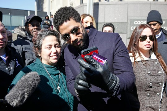 CHICAGO, ILLINOIS - MARCH 26: A fan takes a selfie with actor Jussie Smollett following his court appearance at Leighton Courthouse on March 26, 2019 in Chicago, Illinois. This morning in court it was announced that all charges were dropped against the actor. (Photo by Nuccio DiNuzzo/Getty Images)