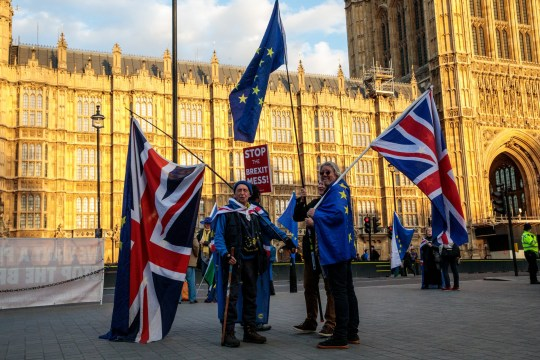 LONDON, ENGLAND - MARCH 26: Anti-Brexit protesters demonstrate outside the Houses of Parliament in Westminster on March 26, 2019 in London, England. British Prime Minister Theresa May is facing increased pressure to resign as she continues her attempts to pass a Brexit deal through Parliament.(Photo by Jack Taylor/Getty Images)
