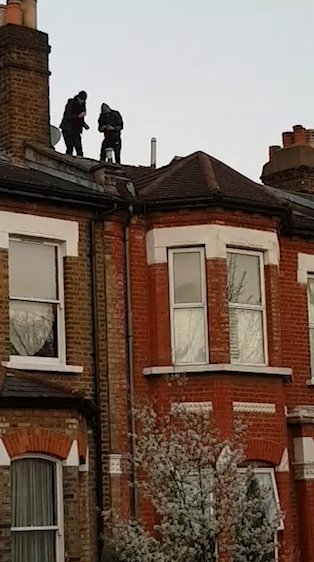 Armed burglars' are in stand-off with police after fleeing onto London home rooftops when officers tried to arrest them over 'motorbike theft' Met Police approached two men at 5pm who were tampering with a motorbike The duo fled onto rooftops in Kingsgate Road, near Kilburn, northwest London Grabs: Burglars in Kilburn