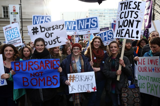 LONDON, ENGLAND - JANUARY 09: Student nurses and health workers take part in a demonstration against government plans to scrap the NHS bursary on January 9, 2016 in London, England. The government are proposing to scrap the bursary and from 2017, are asking future nurses, midwives and other allied health professionals to pay up to ??50,000 to train to care. Future nurses and midwives will find it extremely difficult if not impossible to pay this debt off. (Photo by Carl Court/Getty Images)